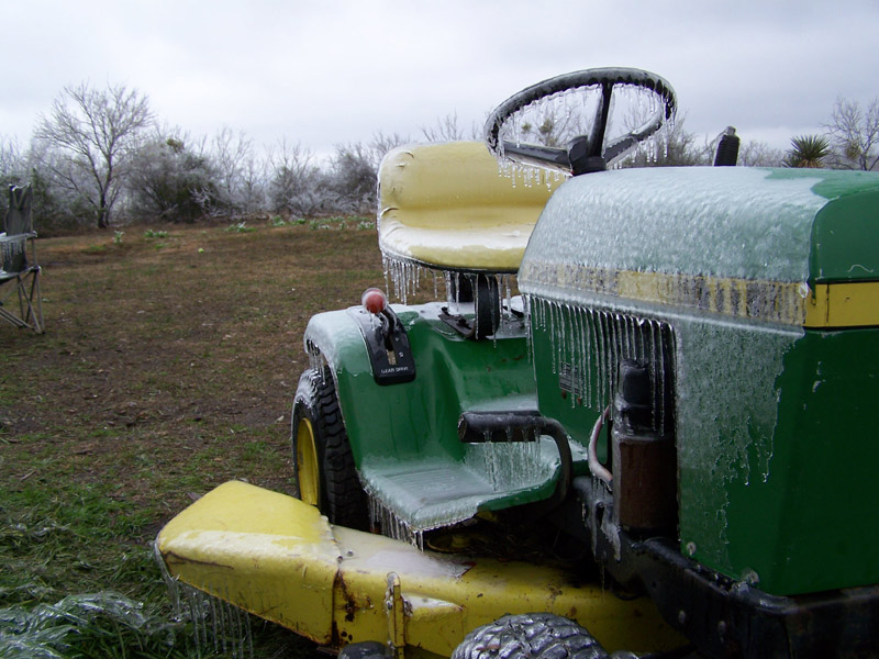 icicles hanging from the john deere riding mower