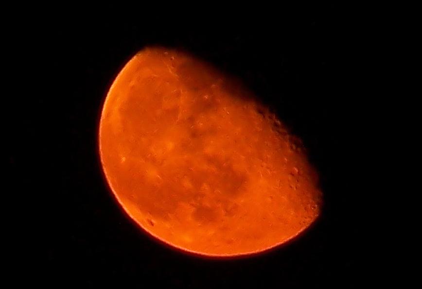 orange red moon over san antonio in september