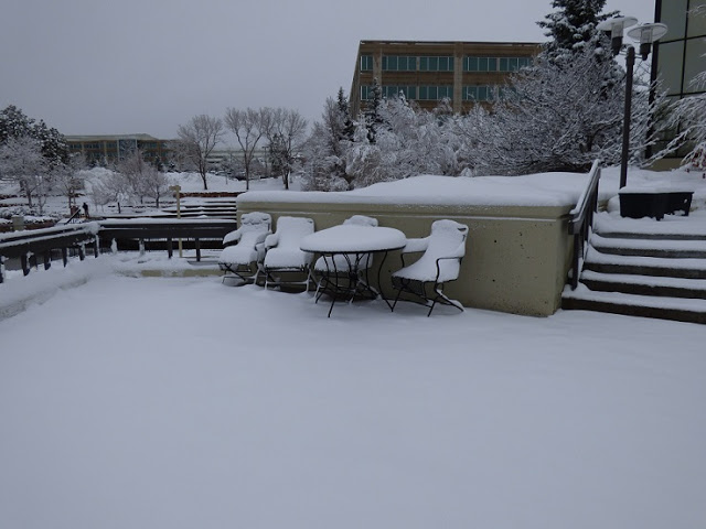 table and chairs in snow